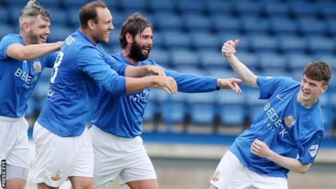 Glenavon celebrate after Jordan Jenkins (right) scores the only goal in the Charity Shield