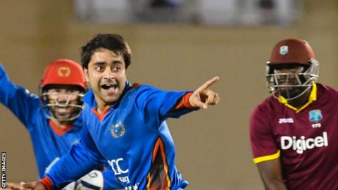 Afghanistan spinner Rashid Khan (centre) celebrates during his country's win over West Indies