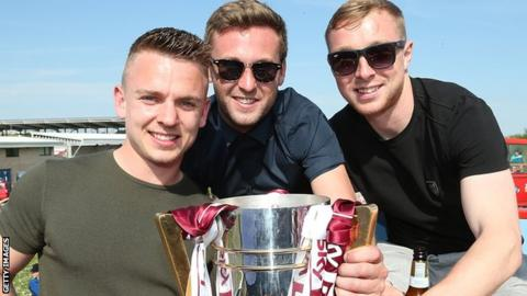 Nicky Adams (right) celebrates the League Two title with teammates