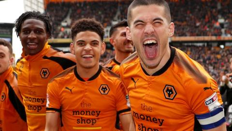 Wolverhampton Wanderers celebrate being promoted to the Premier League