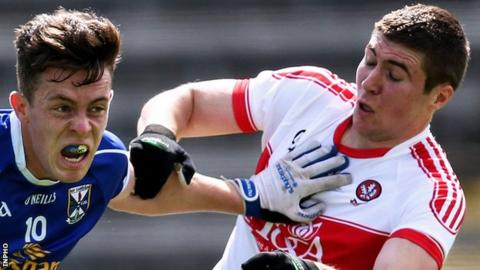 Cavan's Dara McVeety attempts to hold off Ciarán McFaul of Derry