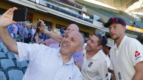 Joe Root poses for photos with fans after England's defeat in the first Test in Brisbane