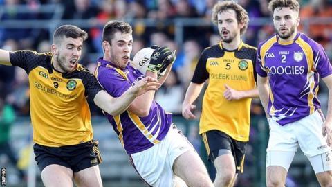 Ryan Lyons of Erne Gaels challenges Derrygonnelly's Ryan Jones in Sunday's final