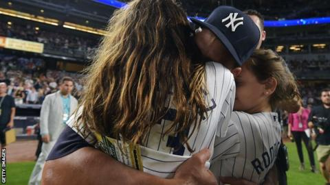 Alex Rodriguez hugs his daughters Natasha and Ella