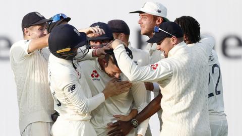England celebrate after Joe Denly's catch dismissed Tim Paine