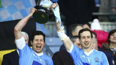 Brothers Sean and Colm Cavanagh lift the trophy after Moy's six-point success at Croke Park in Dublin