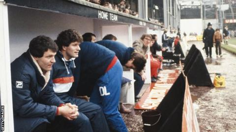John Toshack in the dug-out at the Vetch Field as Swansea manager in a match against Liverpool