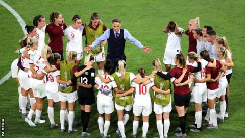England boss Phil Neville in a huddle with his players during the Women's World Cup