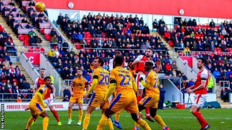 Clark Robertson heads for goal