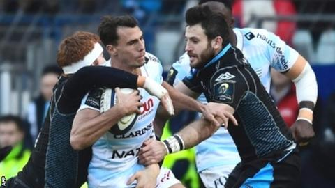 Racing wing Juan Imhoff is tackled by Glasgow's Rob Harley (left) and Tommy Seymour