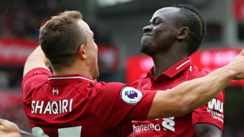 Xherdan Shaqiri and Sadio Mane celebrate