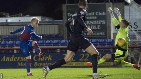 Connor Bell scores