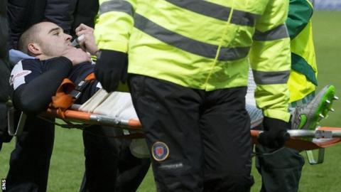 James McPake is stretchered off