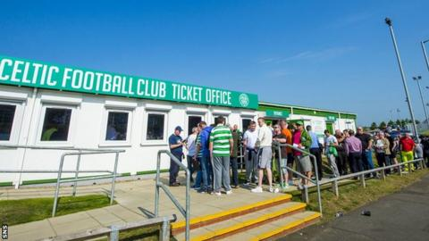 Celtic fans queue outside the ticket office