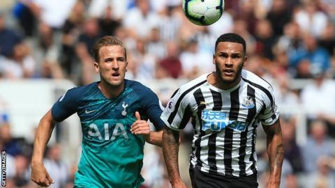 Tottenham's Harry Kane chases the ball with Newcastle's Jamaal Lascelles