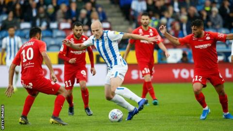 Aaron Mooy in action for Huddersfield