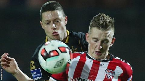 Derry striker Ronan Curtis battles with Dundalk's Shane Grimes in this season's FAI Cup semi-final replay