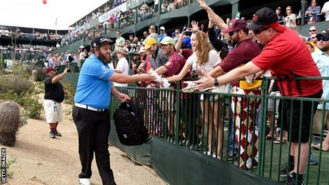 Andrew Johnston giving gifts to fans