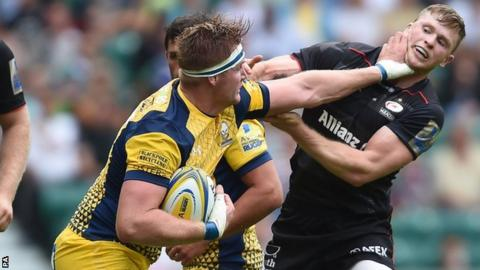 Gj Van Velze fends off Saracens & England wing Chris Ashton on the opening weekend of the season
