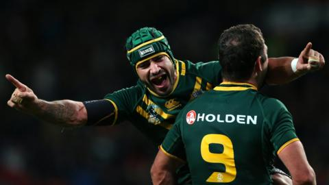 Johnathan Thurston and Cameron Smith of Australia celebrate after victory over New Zealand in the Rugby League World Cup Final between New Zealand and Australia at Old Trafford on November 30, 2013 in Manchester, England