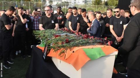 Players and management of Alanyaspor attend a ceremony in honour of Sural