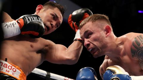 Carl Frampton evades a punch from Nonito Donaire in Belfast