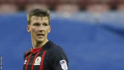 Dons defender leaves to Blackburn Rovers