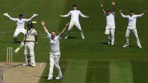 Ollie Robinson (third from left) appeals for a wicket at Hove
