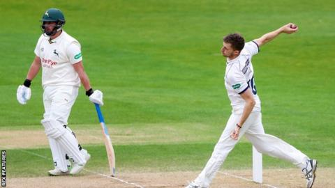 Side-on view of Ben Coad bowling for Yorkshire against Nottinghamshire