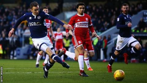 Millwall midfielder Jed Wallace scores the opening goal against Middlesbrough at the Den