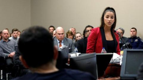 Three-time Olympic gold medallist Aly Raisman addresses the court