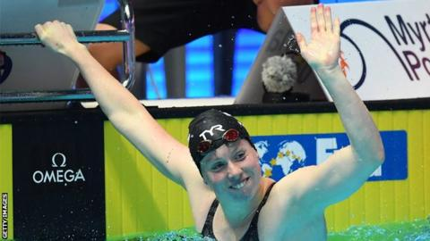 US swimmer Lilly King waves after winning gold in the 100m breaststroke at the 2019 world championships