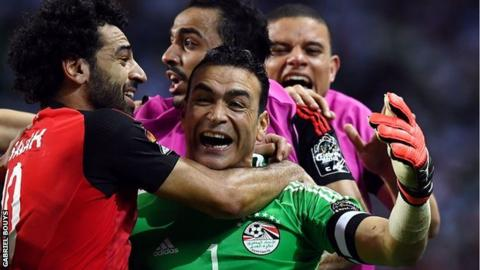 Essam El Hadary is mobbed by his team-mates after the penalty shootout win over Burkina Faso