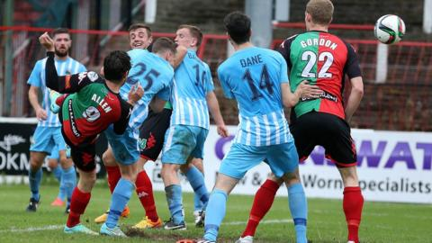 Curtis Allen scores the second of his two goals in Glentoran's 2-1 home win over Warrenpoint Town