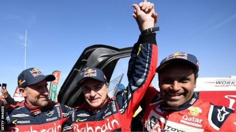 Carlos Sainz celebrates winning the 2020 Dakar Rally