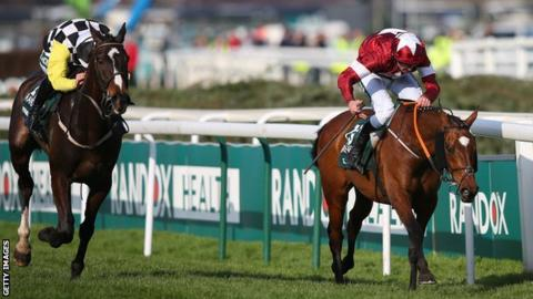 Horse Tiger Roll (right) ridden by jockey Davy Russell edges out Pleasant Company (left) ridden by David Mullins at the finish of the 2018 Grand National