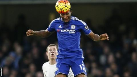 John Mikel Obi heads the ball