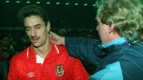 Ian Rush is consoled after the defeat to Romania by manager Terry Yorath, whose contract would not be renewed by the Football Association of Wales.
