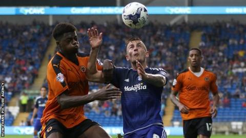Joe Ralls of Cardiff City and Dominic Iorfa of Wolves