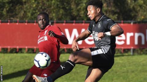 Ali Kioki (right) in action for Burnley under-23s