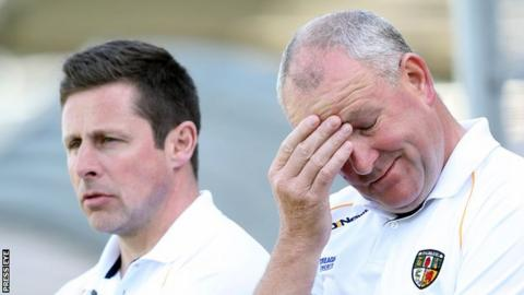 Frank Fitzsimons (right) shows his frustration during Antrim's defeat by Donegal in May as Gearoid Adams also watches on