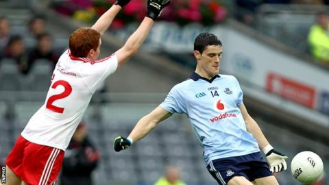 Tyrone's Peter Harte attempts to block a Diarmuid Connolly shot during the 2011 All-Ireland quarter-final