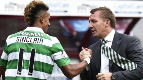 Celtic winger Scott Sinclair is congratulated by manager Brendan Rodgers
