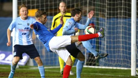 Linfield's Kirk Millar gets his volley away in the Shield decider on Tuesday night