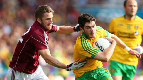 Galway's Michael Lundy gets to grips with Donegal goalscorer Ryan McHugh in the second match of Saturday's double-header of Round 4B qualifiers at Croke Park