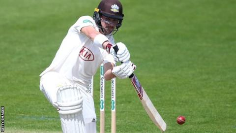 Surrey captain Rory Burns plays a shot on his way to his century against Somerset