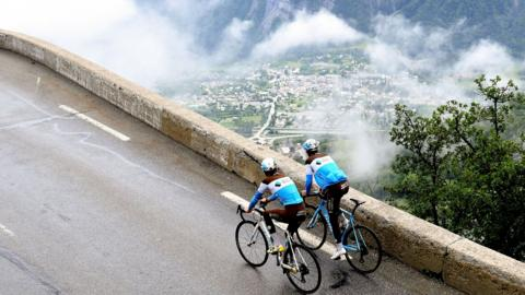 France's Romain Bardet (R) and France's Tony Gallopin of France's AG2R cycling team ride during a track reconnaissance on the road towards the Alpe d'Huez's summit, on June 13, 2018, as part of his preparation for the 2018 Tour de France. (Photo by JEAN-PIERRE CLATOT / AFP) (Photo credit should read JEAN-PIERRE CLATOT/AFP/Getty Images)