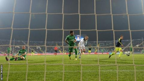 Mesut Ozil (right) scores Arsenal's winner in Bulgaria