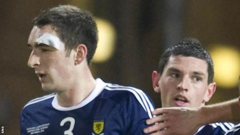 Lee Wallace and Graham Dorrans in action for Scotland