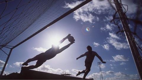 Footballer's shadow